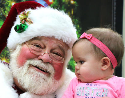 Seven-month-old Lilah Mattingly is in complete awe of Santa Claus. She is the daughter of Dustin and Jessica Mattingly of Lexington.