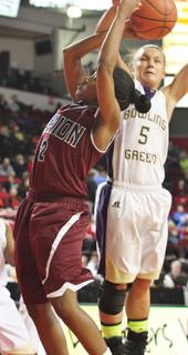 Senior Patrice Tonge goes in strong against a Bowling Green defender last Wednesday afternoon at Diddle Arena.