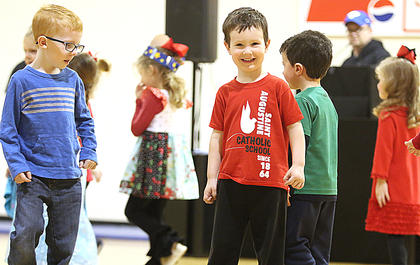 Preschooler Eliot Osbourne smiles at the crowd.