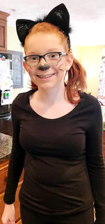 Emma Hardin transforms into a cat for Halloween.