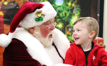 Rylan May, 3, of Lebanon shares a laugh with Santa Claus Friday evening. He is the son of Michael May and Katie Jones.