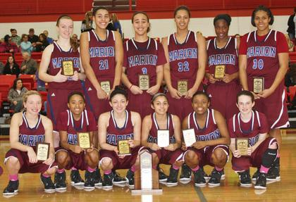 Pictured are members of the Marion County Lady Knights who captured the teams seventh consecutive district crown with a 72-41 win over Adair County last Saturday night.