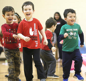 Cousins Salem Bowman, Eliot Osbourne and Dylan Leathers perform with their preschool classmates.