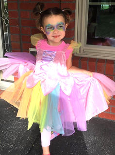 Kinlee Hamilton is dressed as Rainbow Dash from My Little Ponies.