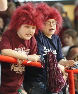 Two young Marion County fans wear the maroon hair to support the Lady Knights.
