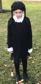 Scarlett Blanford, daughter of Erica Cecil and Brian Blanford, is dressed as Wednesday Addams for Halloween.