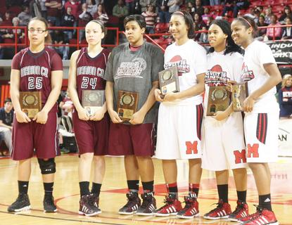 Pictured are members of the Sweet Sixteen Girls' State Basketball All-Tournament Team from Marion County and Manual.