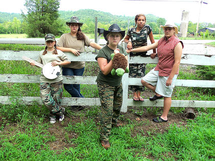 "Sophia Brown and her friends are huge fans of the Turtleman. Sophia and her friends make Turtleman videos for the Turtle Crew and they seem to be a big hit. Brown is 12 years old and is a seventh grader at Casey county Middle School. So, why does she love the Turtleman so much? ""It's that awesome rebel yell,"" Brown's mother, Christina said. ""And he tries to help the turtles and animals, and because he makes turtle catching look fun."" Pictured are Sophia Brown (Turtlegirl), Lashaya Carman (standing, back left), Jezreel Davis (standing, back right) Kaitlyn Sallee (holding banjo)  and Holly Christian (leg propped up on fence)."