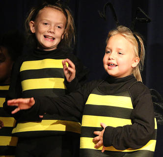 Jillian Spalding and Eleanor Stewart make very cute bumble bees.