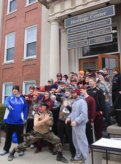 The Turtleman poses outside of the heritage center with a group of fans.