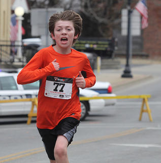 Austin Montgomery, 10, pushes with all his might as he nears the finish line.