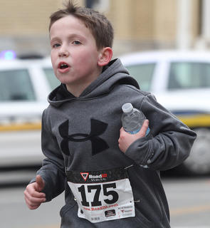 Ethan Scott, 9, pushes forward as he nears the end of the race.