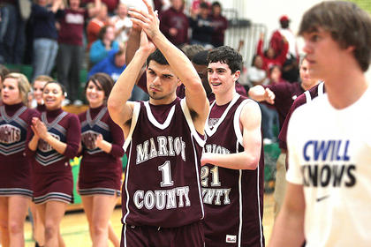 Senior Josh Brockman and junior John Southall celebrate after defeating the LaRue County Hawks 55-53 in opening round action of the boys 5th Region tournament.
