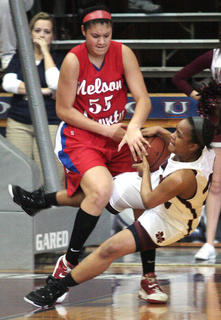 Senior Shakila Goodin rips a rebound away from Nelson County's Sierra Drake in the semi-final round of the regional tournament.