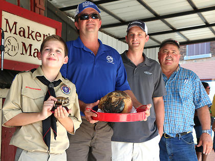 Pictured are Ty Barker, Timmy Jones, Justin Craig and Steve Downs, who purchased Barker's champion ham.