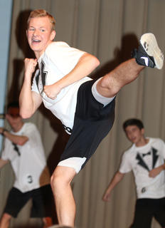 Matthew Huff shows off his kicking abilities during the physical fitness competition.