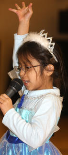 """Juliana Dixon sings a song from the movie """"Frozen."""""""