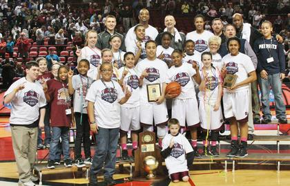 Pictured are members and coaching staff of the Lady Knights varsity basketball team who won the 2013 Houchens Industries/KHSAA Girls' Sweet 16 State Basketball Tournament Saturday night at E.A. Diddle Arena in Bowling Green.