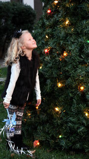Raegan Wright had the honors of lighting the Christmas tree and kicking off the Dickens Christmas events Friday evening. She is the daughter of Ashley and Andy Wright of Lebanon and a student at A.C. Glasscock Elementary School.