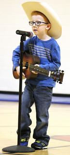 "Lawton Gorley sings and plays guitar to the song ""Wagon Wheel."""