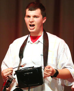"Michael Richardson performs a ""Toast Tribute"" during the talent portion of the competition."