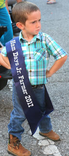 Lucas Green, 4, struts his stuff after winning the Junior Farmer competition. He is the son of Ashley and Anthony Green.