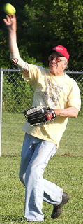 DeLane Pinkston, pastor at Pleasant Valley Christian Church and long-time Marion County school board member, throws the ball from the outfield.