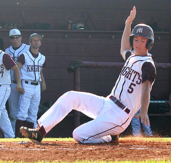 Andrew Spalding slides across home plate against the Nelson County Cardinals.