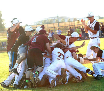 The Knights pile on top of each other in celebration after winning the regional title game.