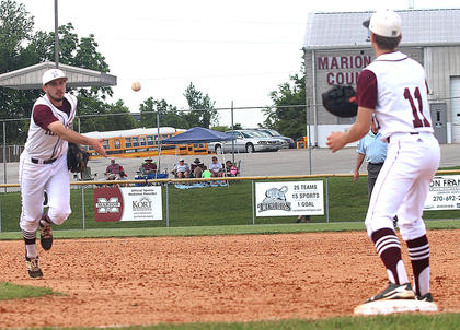 Travis Wiser tosses the ball to first baseman Luke Thomas for an out against Hart County.