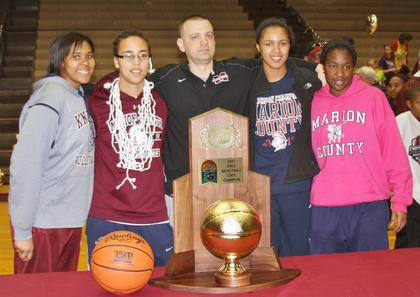 The four seniors (Logan Powell, Makayla Epps, Kyvin Goodin-Rogers, and Patrice Tonge) and Head Coach Trent Milby stand with the 2013 Sweet Sixteen championship trophy.