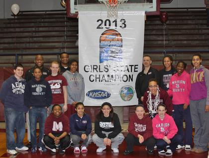Pictured are the 2012-2013 Marion County Lady Knights basketball team and coaching staff with the Sweet 16 championship banner.