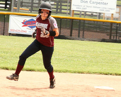 Jordan Browning rounds second base in Marion County's 13-3 win over Russell Flatwoods in July 10.