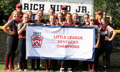 #4: Pictured is the Marion County 10-12 All-Stars, who won the state title with a 10-0 win over North Oldham. The win sent to 10-12 All-Stars to the little League Softball Central Region Tournament in Indianapolis. Pictured, from left, are Charleigh Browning, Assistant Coach Tim Wright, Marisa Nulle, Jordan Browning, Aubrey Knopp, Brooklynne Bland, Leah Wright, Emma Sullivan, Lily Thompson, Head Coach Joe Browning, Ann Taylor Rakes, Emily Clark, Emily Tungate, Brooklyn Gaddie, Assistant Coach Troy Overstreet and Marybeth Overstreet.