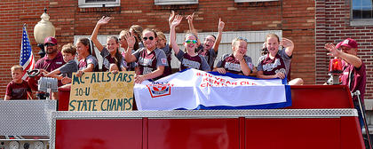 The Marion County 8-10 All-Stars make their way down Main Street in a victory parade. The 8-10 All-Stats defeated Boyd County 4-2 for the state title.