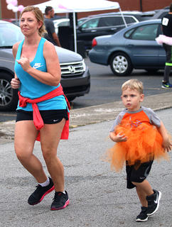 Lauren Spalding runs with her son Colton.