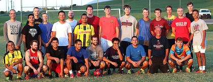 Pictured are former Marion County High School boys soccer players, as well as current soccer coaches, who played in the alumni soccer game Friday. The red team defeated the blue team, 8-6.