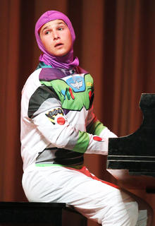 """Kelly Mattingly performs Elton John's """"Rocket Man"""" during a music montage during the talent competition."""