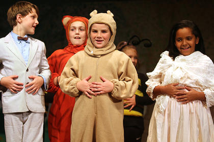 Pictured, from left, are Christopher Robin played by Jackson Hayes, Tigger played by Izzy Lyvers, Winnie the Pooh played by Mya Kehm, and the narrator, played by India Young.