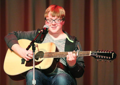 Gavin Hasty performs a guitar solo during the talent portion of the competition.