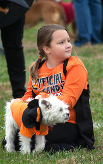 Waiting patiently, Briley Mudd and her dog Benji sit in the competitor&#039;s area after being interviewed in a contest. 