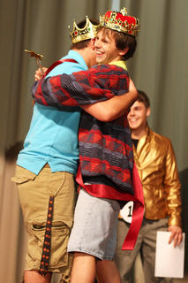 2011 Junior Mister Dalton Mills hugs Evan Childers, the 2010 Junior Mister, after being crowned the winner.