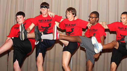 Junior Mister participants do the Can-Can during the fitness portion of the competition. They are, from left, Jared May, Cody Farmer, Dalton Mills, Trell Cooper and Hector Santiago.