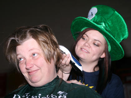 Karen Smith of MAC sat down to have her head shaved for the third time. Taylor Claypool did the honors.