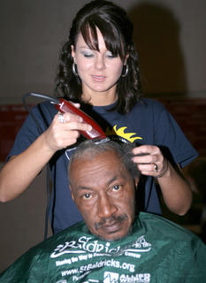 Joe Downs returned to St. Baldrick's for the second time this year. Mindy Garrett gave him his haircut.
