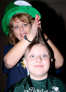 Stylist Kim Childers has a little fun before shaving the head of Sammi Jo Potter, 10. Potter is a four-time shavee.