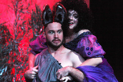 Starr Garrett, playing the part of Titania, queen of the fairies, magically falls in love with Bottom, played by J.P. Allen. Bottom has been given the head of an ass by Puck.