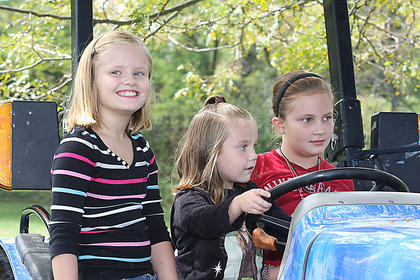 Children learn about seat belt safety on a tractor provided by Marion County High School's Future Farmers of America chapter.