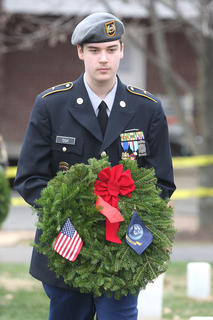 MCHS ROTC cadet John Cox lays a remembrance wreath in memory of those who served and are serving in the United States Navy. 