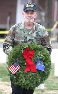 Infantry Staff Sgt. Retired Barney Tharp lays a remembrance wreath in memory of those who served and are serving in the United States Air force.